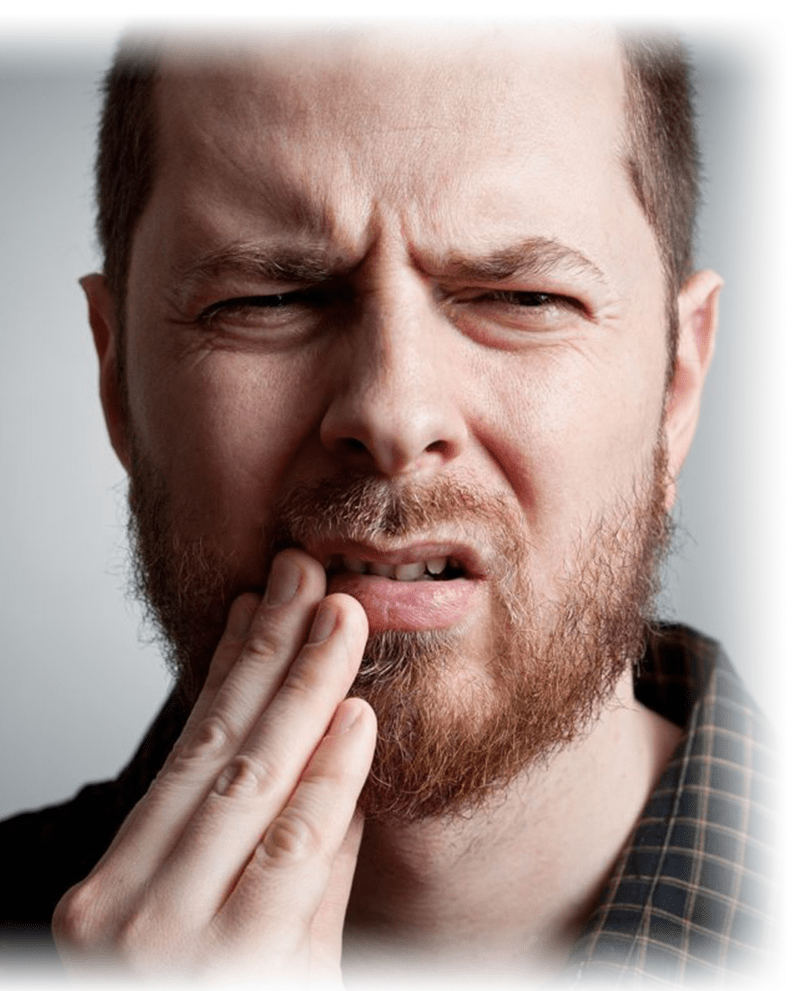 patient with toothache holding face