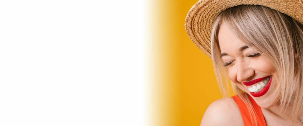 cosmetic dental patient wearing sunhat